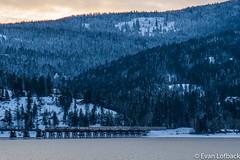 Amtrak 8 at Sandpoint, ID (evanlofback) Tags: railroadbnsf spokanesub engineamtk amtrak8 empirebuilder sandpoint sunrise mountains bridge water winter snow passenger