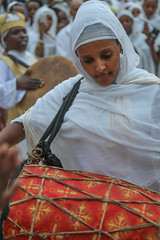 Dive into the music (ybiberman) Tags: israel jerusalem oldcity alquds christianquarter churchoftheholysepulchre deirelsultan woman ethiopian drum playing feast concentrated veil white portrait candid streetphotography people