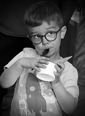 Cone in a cup (tvdflickr) Tags: child boy male glasses icecream cone cup eating candid monochrome georgia marietta fuji fujifilm fujifilmx100f photobytomdriggers thomasdriggersphotography candidportrait
