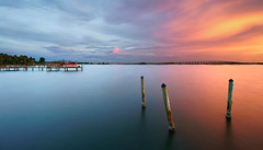 We're still waiting. (Jill Bazeley) Tags: indian river lagoon intracoastal waterway piling pilings hurrican damage dock pier sunset motor boat power motorboat long exposure smooth reflection sony a7rii 1018mm brevard county florida merritt island usa seascape shoreline shore bridge sunrise dawn hurricane storm tropical cyclone amanecer atardecer huracan dano orilla laguna coast space costa