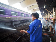 Bangkok Hua Lamphong Train Station-3262951 (Neil.Simmons) Tags: bangkok thailand southeastasia streetphotography hua lamphong hualamphong train station candid asia purple laowa 75mm f2 ultra wide platform carriage car hose water worker smoke smoker cigarette spray clean wash