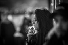the smoke of bliss (Gerrit-Jan Visser) Tags: bewerkt streetphotography amsterdam blackandwhite smoking smoke woman cigarette bliss streetportrait staring