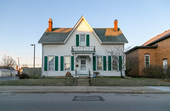 House — Mount Sterling, Ohio (Pythaglio) Tags: house dwelling mountsterling ohio unitedstatesofamerica us residence historic 15story chimneys centralpassage shutters porch spandrels gable gothicrevival street sidewalk steps bushes madisoncounty fivebay 11windows vinylsiding altered
