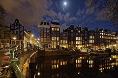 Amsterdam. (alamsterdam) Tags: amsterdam bridge canal prinsengracht evening longexposure reflection sky clouds cars bikes architecture moon
