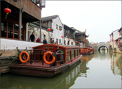 Suzhou Canal (Mary Faith.) Tags: suzhou canal boats tourism people buildings houses reflections bridge china lanterns waterway