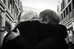 Hugs (Bury Gardener) Tags: monochrome mono burystedmunds bw blackandwhite britain 2018 nikond7200 nikon england eastanglia uk people peoplewatching folks suffolk streetphotography street streetcandids strangers candid candids arc thearc