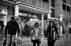 Carrying the Bags and Getting Wet (Bury Gardener) Tags: burystedmunds bw blackandwhite britain monochrome mono england eastanglia uk people peoplewatching folks nikond7200 nikon suffolk streetphotography street streetcandids snaps strangers candid candids 2018 arc thearc