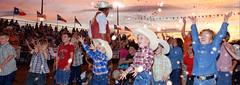 A Moment in Time Cowpoke Children Rodeo Bowie Texas Sunset Sky Cowboy Hats Blue Jeans Boots Smiles Flags 82009 (David Kozlowski) Tags: davidkozlowski dallasphotoworks rodeo jimbowiedays bowietexas texas cowpoke kids america smiles cowboys sundown sunset jeans cowboyhats flags explore01jul07 interestingness1 nikonstunninggallery unscenetexas2007 unscenefinalist unscenetour wallkandy dallasphotographer fortworthphotographer distinctive unique beautiful photographer awardwinning man ©david kozlowski dallasphotoworkscom all rights reserved children bowie sky cowboy hats blue boots