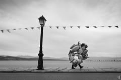 Balloon salesman (tzevang.com) Tags: mani balloon salesman greece bythesea bw walking