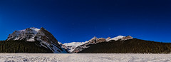 Lake Louise Panorama by Winter Moonlight (Amazing Sky Photography) Tags: acr alberta banffnationalpark hyades lakelouise march moonlight mountfairview mtstpiran orion pleiades victoriaglacier waxing wintersky ice panorama setting snow stars