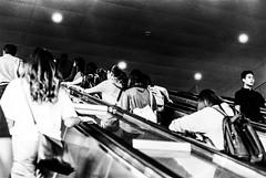 Commuters (Thanathip Moolvong) Tags: nikon fm kodak 400tx city commuter escalator people mrt subway metro