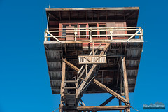 Rickety Tower (kevin-palmer) Tags: custernationalforest ashland montana december winter sunny blue sky nikond750 tamron2470mmf28 yagerbutte firelookouttower old abandoned tall structure hills afternoon deck railing stairs red