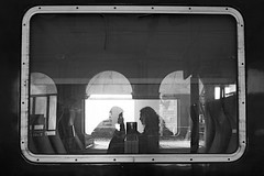 Love in the train (lesphotosdepatrick) Tags: candidphotography blackandwhitephotography fujifilm x100f sncf train love couple