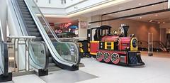 """Rail Fares Are Going Up"" (standhisround) Tags: watford hertfordshire england uk shoppingmall engine train escalator shops"