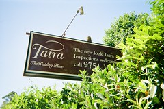 Tatra - The Wedding Place (Matthew Paul Argall) Tags: kodakflashsingleusecamera fixedfocus 35mmfilm 800isofilm kodak800 disposablecamera singleusecamera sign