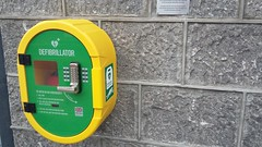 Defibrillator, Torry, Aberdeen, Feb 2019 (allanmaciver) Tags: public access defibrillator health wellbeing saves lives red rox events old torry community centre local people scottish ambulance police station granite yellow green pulse improvement allanmaciver aberdeen north east