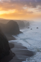 Cliffs of Gold (Bob Bowman Photography) Tags: ocean sunrise sea coast california sonoma sonomacoast waves fog mist atmosphere cliffs clouds color light sand rocks nikon northerncalifornia beach