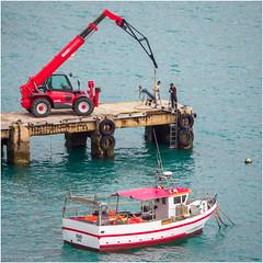 Maintenance of the mooring jetty (Luc V. de Zeeuw) Tags: boot crane jetty man mooring ship water sagres algarve portugal