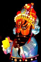 Laying Down the Law (Seeing Visions) Tags: 2018 unitedstates us losangelescounty la arcadia laarboretum moonlightforest chineselanternfestival night dark colorful cloth light headdress costume redface beard raymondfujioka