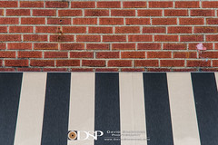 Brevard, NC (David Simchock Photography) Tags: brevard meetup vpw vagabondphotowalks awning black brick facade image minimalism minimalist photo photograph stripe wall white northcarolina usa