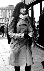 Near Starbucks (Owen J Fitzpatrick) Tags: ojf people photography nikon fitzpatrick owen pretty pavement chasing d3100 ireland editorial use only ojfitzpatrick eire dublin republic city tamron candid joe candidphotography candidphoto unposed natural attractive beauty beautiful woman female lady j along photoshoot street 2018 dslr digital streetphoto streetphotography black white mono blackwhite blackandwhite monochrome blancoynegro pretoebranco bw face dublinshoot centre saturday december oconnell trench coat brunette scarf hair long button irish glove ladies girl girls portrait