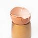Crashed Eggshell on the wooden holder