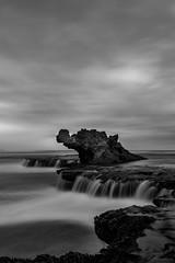 The dragon stands watch over the sea (Sean Greenland) Tags: miniwaterfall falls weather exposure blackandwhite ocean dragon longexposure sea