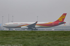 B-303C - 2018 build Airbus A330-343E, rolling for departure on Runway 23R at a misty, grey  Manchester (egcc) Tags: 1896 a330 a330300 a330343e a333 airbus b303c chh egcc hna hu hainanairlines lightroom man manchester ringway