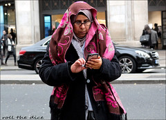 `2511 (roll the dice) Tags: london westminster westend people fashion pretty sexy girls mad sad fun funny surreal streetphotography colour cold urban unaware unknown england uk art classic lights portrait stranger candid canon tourism tourists shopping crowd scarf mobile phone talk car blur traffic muslim glasses headscarf oxfordstreet tex fingers