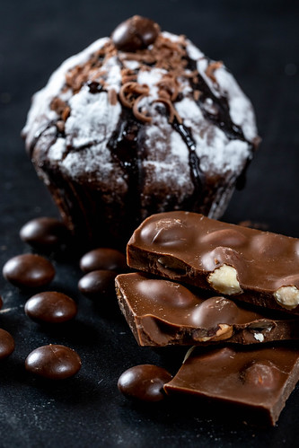 Chocolate cake with chocolate cubes with nuts