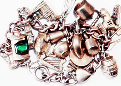 Jewellery. (karl from perivale) Tags: jewellery gold charms chain colourful indoor macromonday macromondays hmm