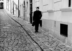 Off to work (halifaxlight (back in late March)) Tags: slovakia bratislava street man walking cobblestones city urban buildings doors sidewalk briefcase workday bw slope steps