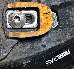 Shimano Cycle Shoe Detail (Mr_Pudd) Tags: cycleshoe shimano cleat macromonday lookingup shoe worn cycling yellow fibreglass ventilationhole sole hexbolt allenbolt muck dirt mud plastic