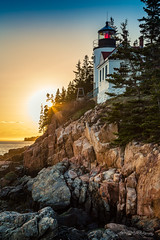Golden Hour in Acadia (dan@propeakphotography.com) Tags: acadianationalpark america architecture bassharbor bassharborheadlight blue bluehillbay blueskies bluesky buildings clouds coast colors famousplace fence goldenhour green horizon iconic internationallandmark lighthouse maine mountdesertisland nps nationalpark nationalregisterofhistoricplaces nature newengland northamerica orange places red rocks shoreline spring sun sunrays sunset touristattraction travel traveldestination travelandtourism trees usa unitedstates water yellow 300faves