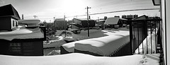 View After the Blizzard 3 (sjrankin) Tags: 21january2019 edited panorama sky sun weather clouds snow houses wires lines neighborhood balcony kitahiroshima hokkaido japan grayscale 1044mb large
