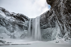 Winter is Coming II (B.E.K. Photography) Tags: iceland skogafoss winter blizzard water waterfall sky clouds mountain cliff ice snow icicle longexposure white blue outdoor landscape river stream nikond850 nikon1735f28