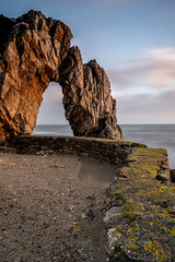 Porth Wen Sea Arch (RichRobson) Tags: amlwch seaarch sky water arch rock ocean sea goldenhour morninglight wales porthwenbrickworks anglesey brickworks sunrise glow