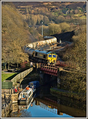 Journeys through the past (david.hayes77) Tags: cement transport winter yorkshire westyorkshire huddersfieldnarrowcanal shed freightliner class66 66604 cargo 6m22 2019 narrowboat standedge standedgetunnel tanks moorland moors pennines barge reflections colnevalley bridge marsden journeysthroughthepast landscape
