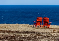 Chairs of Red (Karen_Chappell) Tags: chair chairs red blue ocean sea seascape landscape torbay nfld newfoundland avalonpeninsula eastcoast atlanticcanada atlantic canada eastcoasttrail spring scenery scenic tourism