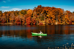 Kayaker in Autumn [11.01.18] (Andrew H Wagner   AHWagner Photo) Tags: 5dmk3 5d3 5dmkiii 5dmarkiii 5dmark3 canon eos 50l 50mm f12 f12l md maryland outdoors outside explore exploration exploring hiking nature trees tree fall autumn prettyboyreservoir prettyboy reservoir water landscape kayaker kayak person portrait candid colors red orange yellow blue