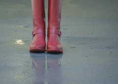 of red boots and rain.jpg (remiklitsch) Tags: rain red boots reflection puddle weather remiklitsch nikon miksang street city urban winter