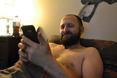 Relaxing in Bed (Vegan Butterfly) Tags: person people man bed phone beard smile smiling