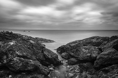 Black Rocks (panos_adgr) Tags: nikon d7200 long exposure photography monochrome bw drama winter landscape motion blur sounio attica greece seascape beach black rocks shore sky clouds sea water