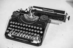 text editor that doesn't crash (jernej.cucek) Tags: blackandwhite person text signage bw monochrome street art streetart timeless time shadow black light white typewriter vintage