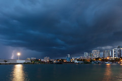 Tropical storm over Darwin (Louise Denton) Tags: darwin storm weather lightning bolt blue dusk evening nt northernterritory australia sea ocean water wetseason light