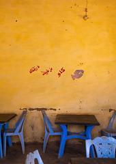 Empty fish restaurant, Northern State, Karima, Sudan (Eric Lafforgue) Tags: africa arabic calligraphy chairs colorimage copyspace day foodanddrink indoors karima nopeople northafrica northsudan northernprovince northernsudan photography restaurant sudan sudan180630 table traveldestinations vertical yellow northernstate