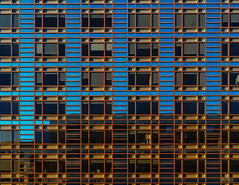 Flows of Blue (The way Mike sees it) Tags: facade building lines shape pattern parallel blue orange yellow green color windows