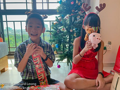 Ethan wants to open another (Stinkee Beek) Tags: christmas erin ethan