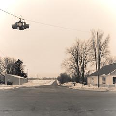 Mulliken Road (joeldinda) Tags: streetlamp building drift tree thriftway village paved road gray grey february 4471 cloud sky graysky greysky g9x 2019 powershotg9xii canon michigan mulliken snow winter weather 51365