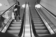 I see you (Zesk MF) Tags: bw black white mono zesk cologne rollstreppe street candid woman escalator people streetlife x100f fuji
